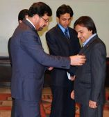 Receiving medal for high civil service in the field of counter narcotics from the Minister of counter Narcotics Afghanistan.